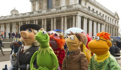 "This image released by Disney shows muppet characters, from left, Gonzo, Miss Piggy, Kermit, Floyd Walter and Scooter in a scene from ""Muppets Most Wanted."" (AP Photo/Disney Enterprises, Inc., Jay Maidment)"