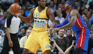 Denver Nuggets forward Kenneth Faried, left, looks to pass ball as Detroit Pistons forward Josh Smith covers in the first quarter of an NBA basketball game in Denver on Wednesday, March 19, 2014. (AP Photo/David Zalubowski)