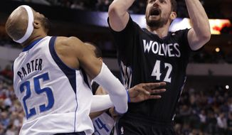 Minnesota Timberwolves forward Kevin Love (42) shoots against Dallas Mavericks guard Vince Carter (25) during the first half an NBA basketball game Wednesday, March 19, 2014, in Dallas. (AP Photo/LM Otero)