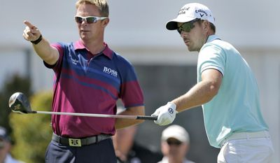 Henrick Stenston, of Sweden, right, points with his caddie Gareth Lord during a practice round for the Arnold Palmer Invitational golf tournament at Bay Hill, Wednesday, March 19, 2014, in Orlando, Fla. (AP Photo/Chris O'Meara)