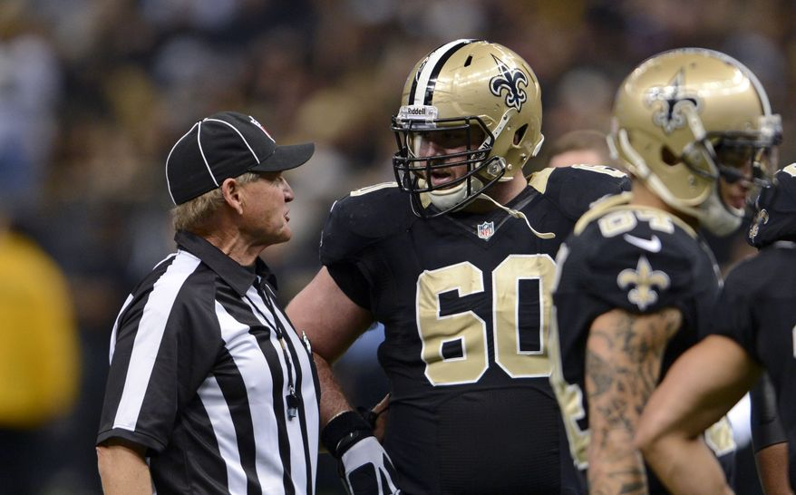 New Orleans Saints center Brian De La Puente (60) talks to an official in the first half of an NFL football game against the Tampa Bay Buccaneers in New Orleans, Sunday, Dec. 29, 2013. (AP Photo/Bill Feig)