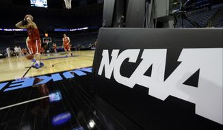American University players warm up during a practice session for their NCAA college basketball tournament game Wednesday, March 19, 2014, in Milwaukee. American plays Wisconsin in round two on Thursday. (AP Photo/Morry Gash)