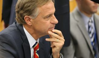 Tennessee Gov. Bill Haslam, discusses Common Core with Rutherford County teachers, principals, and school officials at Cedar Grove Elementary School in Smyrna, Tenn., Tuesday, March 18, 2014, on his tour to 3 schools across the state Tuesday.  (AP Photo/Daily News Journal, Helen Comer)