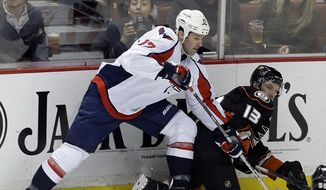 Washington Capitals right winger Dustin Penner (17) tangles with Anaheim Ducks center Nick Bonino (13) during the second period of an NHL hockey game Tuesday, March 18, 2014, in Anaheim, Calif. (AP Photo/Reed Saxon) ** FILE **