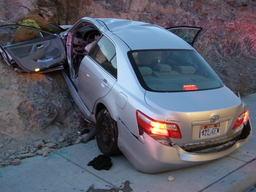 FILE - In this Nov. 5, 2010 file photo released by the Utah Highway Patrol, a Toyota Camry is shown after it crashed as it exited Interstate 80 in Wendover, Utah. Police suspect problems with the Camry's accelerator or floor mat caused the crash that left two people dead and two others injured. The Wall Street Journal is reporting Wednesday March 19, 2014 the U.S. Justice Department may reach a $ 1 billion settlement with Toyota Motor Corp., ending a four-year criminal investigation into the Japanese automaker's disclosure of safety problems. (AP Photo/Utah Highway Patrol, File)