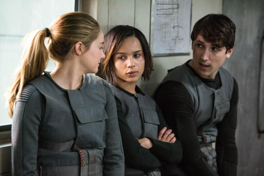 "This photo released by Summit Entertainment, LLC shows, from left, Shailene Woodley as Beatrice ""Tris"" Prior, Zoe Kravitz, as Christina and Ben Lloyd-Hughes as Will in the film, ""Divergent."" (AP Photo/Summit Entertainment, Jaap Buitendijk)"