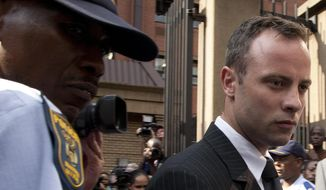 Oscar Pistorius leaves the high court in Pretoria, South Africa, Tuesday, March 18, 2014. Pistorius is charged with murder for the shooting death of his girlfriend, Reeva Steenkamp, on Valentines Day in 2013. (AP Photo/Themba Hadebe)
