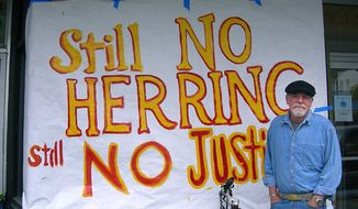 This undated file photo provided by Robert J. Kopchak, shows Robert J. Kopchak standing by a sign in front of the Fisherman's Union Hall in Cordova, Alaska. Kopchak lost a quarter of his earnings when the lucrative Pacific herring fishery crashed in the 1990s after the Exxon Valdez oil spill in Alaska's Prince William Sound. Nearly 25 years after the Exxon Valdez oil spill off the coast of Alaska, some damage heals, some effects linger in Prince William Sound. (AP Photo/Obadiah Kopchak, File) ** NO SALES **