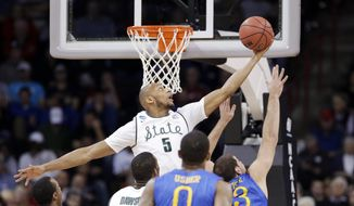Adreian Payne (5) reaches for a loose ball against Delaware in the first half during the second round of the NCAA college basketball tournament in Spokane, Wash., Thursday, March 20, 2014. (AP Photo/Elaine Thompson)