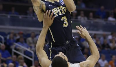 Pittsburgh guard Cameron Wright (3) shoots over Colorado guard Xavier Talton (3) during the second half in a second-round game in the NCAA college basketball tournament Thursday, March 20, 2014, in Orlando, Fla. (AP Photo/John Raoux)