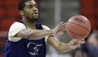 George Washington's Maurice Creek passes the ball during practice at the NCAA college basketball tournament in Raleigh, N.C., Thursday, March 20, 2014. George Washington plays Memphis in a second-round game on Friday. (AP Photo/Gerry Broome)