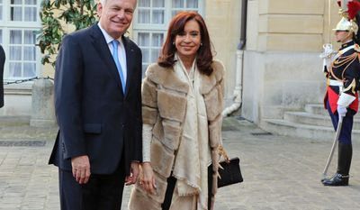Argentine President Cristina Fernandez, right, poses with French prime minister Jean-Marc Ayrault, prior to their meeting at the Hotel Matignon in Paris, Thursday March 20, 2014.(AP Photo/Remy de la Mauviniere)