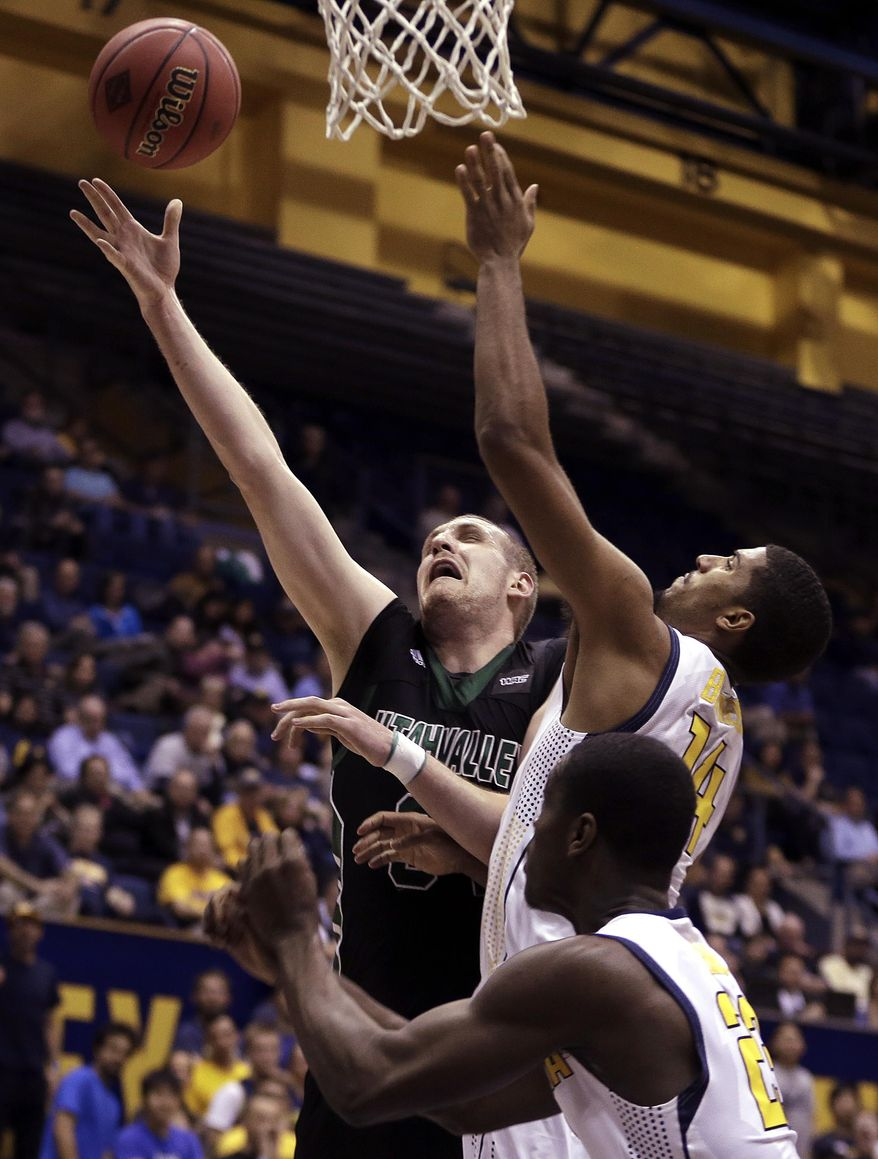 Utah Valley's Ben Aird, left, lays up a shot against California's Christian Behrens, right, and Jabari Bird (23) in the first half of an NCAA college basketball game Wednesday, March 19, 2014, in Berkeley, Calif. (AP Photo/Ben Margot)