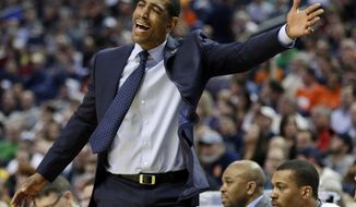 Connecticut head coach Kevin Ollie reacts to a call during the first half of a second-round game against Saint Joseph's in the NCAA college basketball tournament in Buffalo, N.Y., Thursday, March 20, 2014. (AP Photo/Nick LoVerde)
