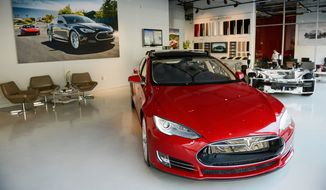 Tesla sells its cars in its own stores, many in high-traffic retail malls. The company says its business model gives it a closer connection to customers. (Andrew Harnik/The Washington Times)