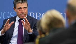 """North Atlantic Treaty Organization (NATO) Secretary General Anders Fogh Rasmussen speaks about """"The Future of the Alliance: Revitalizing NATO for a Changing World,"""" Wednesday, March 19, 2014, at The Brookings Institution in Washington. As it steels itself against westward Russian advances, NATO may find itself stretched too thin to maintain a broad military mission in Afghanistan by its member states beyond this year. U.S. officials said having to divert troops and resources, if not withdrawing completely, from Afghanistan to secure NATO states would be an unintended casualty of the West's new focus on containing Moscow. (AP Photo/Jacquelyn Martin)"""