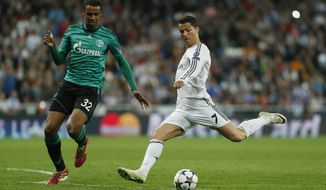 Real's Cristiano Ronaldo, right, in action with Schalke's Joel Matip during a Champions League round of 16 second leg soccer match between Real Madrid and FC Schalke 04 at the Santiago Bernabeu stadium in Madrid, Tuesday, March 18, 2014. (AP Photo/Andres Kudacki)