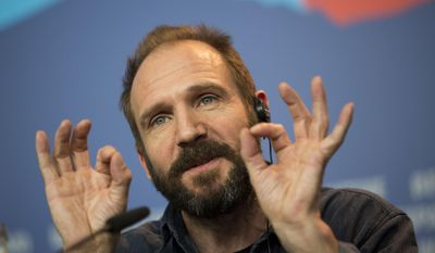 """FILE - This is a Thursday, Feb. 6, 2014 file photo of actor Ralph Fiennes as he answers journalists questions at the press conference for the film The Grand Budapest Hotel during the International Film Festival Berlinale, in Berlin.  New plays by theatrical giants Tom Stoppard and David Hare and the stage return of Ralph Fiennes are highlights of the next year at Britain's National Theatre. The theater announced Thursday March 20, 2014 that Hare's adaptation of Katherine Boo's acclaimed book about Mumbai, """"Behind the Beautiful Forevers,"""" will open in November. Stoppard's as-yet-untitled play will run from January 2015. Fiennes — currently onscreen in Wes Anderson's """"The Grand Budapest Hotel"""" — will star in George Bernard Shaw's political-philosophical drama """"Man and Superman"""" from February. (AP Photo/Axel Schmidt, File)"""