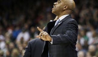 Delaware head coach Monte Ross instructs his team against Michigan State in the first half during a second-round game of the NCAA college basketball tournament in Spokane, Wash., Thursday, March 20, 2014. (AP Photo/Young Kwak)