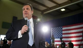 New Jersey Gov. Chris Christie addresses a gathering at a town hall-style meeting, Thursday, March 20, 2014, at St. Magdalen de Pazzi parish center in Flemington, N.J.  Christie says his signature town hall meetings help keep him in tune with what average citizens are thinking. (AP Photo/Matt Rourke)