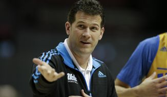 UCLA head coach Steve Alford gestures during practice at the NCAA college basketball tournament Thursday, March 20, 2014, in San Diego. UCLA faces Tulsa in a second-round game on Friday. (AP Photo/Gregory Bull)
