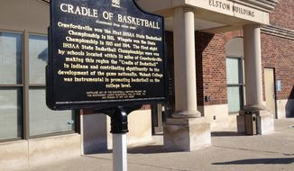 ADVANCE FOR USE SUNDAY, MARCH 23 - This recent photo shows the Indiana Historical Bureau marker in Crawfordsville denoting the site of the first game of basketball played in Indianapolis.  The Terminal Building served as the gym for the Crawfordsville High School basketball team. (AP Photo/The Indianapolis Star, Zak Keefer)  NO SALES