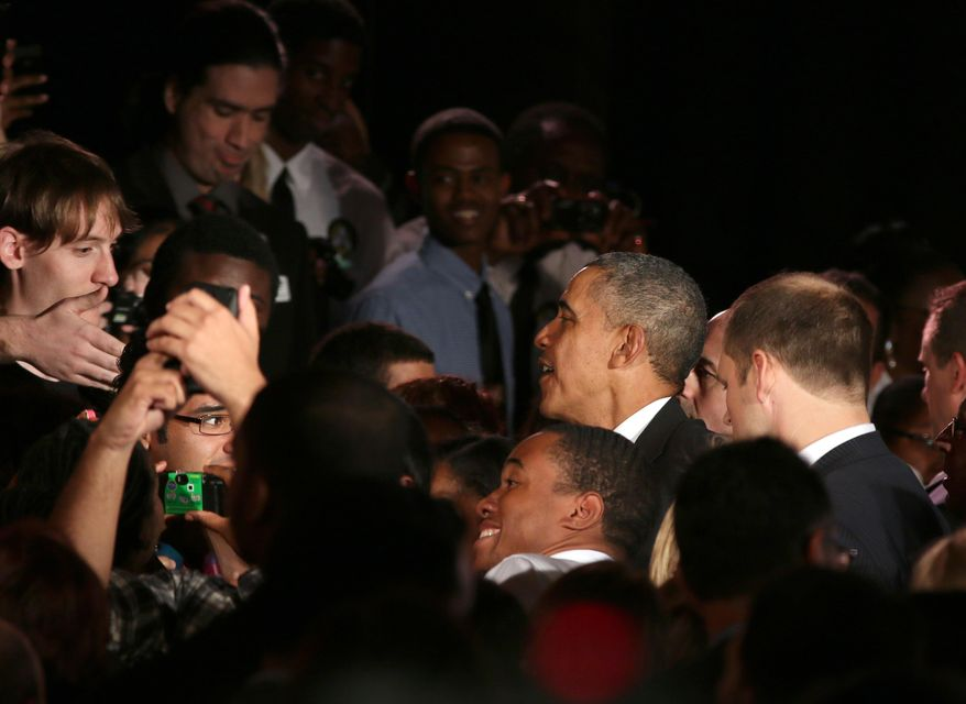 President Barack Obama greets students after speaking at Valencia College in Orlando, Fla., Thursday, March 20, 2014. Obama is visiting the school to highlight women's economic issues. He will also then travel to Miami for a pair of fundraisers for the democrats before returning to Washington later tonight. (AP Photo/Reinhold Matay)