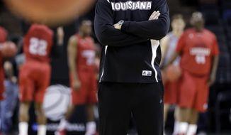 Louisiana-Lafayette head coach Bob Marlin keeps watch over the team's NCAA college basketball tournament practice, Thursday, March 20, 2014, in San Antonio. Louisiana-Lafayette will face Creighton on Friday. (AP Photo/Eric Gay)