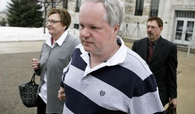 ** FILE ** In this Feb. 17, 2011, file photo, William Melchert-Dinkel, center, leaves the Rice County Courthouse with his attorney Terry Watkins, right, and wife, Joyce Melchert-Dinkel, after waiving his right to a jury trial, in Faribault, Minn. (AP Photo/Robb Long, File)