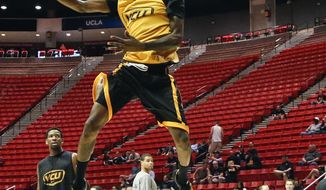 VCU guard Briante Weber goes in for a dunk during practice for the NCAA basketball tournament game Thursday, March 20, 2014, in San Diego. VCU faces Stephen F. Austin in a second-round game on Friday. (AP Photo/Lenny Ignelzi)
