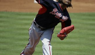 Atlanta Braves starting pitcher Ervin Santana throws in the first inning of an exhibition spring training baseball game against the New York Mets, Thursday, March 20, 2014, in Port St. Lucie, Fla. (AP Photo/David Goldman)