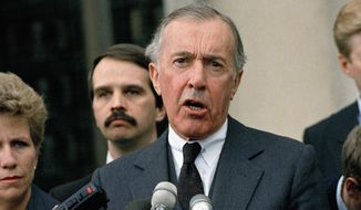 FILE - This May 11, 1989 file photo shows Iran-Contra special prosecutor Lawrence Walsh speaking to reporters outside U.S. District in Washington. Walsh, the Iran-Contra prosecutor who investigated Reagan officials, has died. (AP Photo/Rick Bowmer, File)