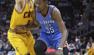 Oklahoma City Thunder's Kevin Durant (35) drives past Cleveland Cavaliers' Matthew Dellavedova (8), from Australia, during the first quarter of an NBA basketball game Thursday, March 20, 2014, in Cleveland. (AP Photo/Tony Dejak)