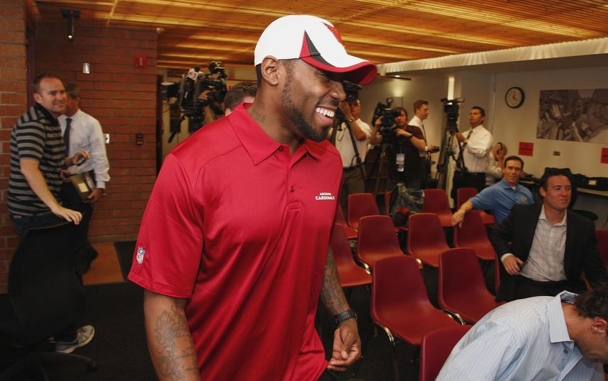 Antonio Cromartie smiles as he arrives for a news conference where the Arizona Cardinals NFL football team introduced its newest player, Thursday, March 20, 2014, in Tempe, Ariz.  Cromartie last played for the New York Jets. (AP Photo/Ross D. Franklin)