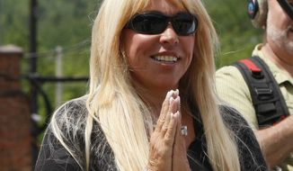 FILE - In this June 10, 2011 file photo, Lynn Tilton is seen in Gorham, N.H. The Justice Department is building a corruption case against a flamboyant Wall Street financier who won millions of dollars in military contracts and then hired the Army officer who steered the money her way.  Interviews and documents obtained by The Associated Press portray entrepreneur Lynn Tilton and Col. Bert Vergez as being in unusually close contact for more than a year before Vergez retired from the Army in late 2012. Among the allegations is that Vergez provided Tilton with details about upcoming contracts to give her company, MD Helicopters of Mesa, Ariz., an advantage over the competition (AP Photo/Robert F. Bukaty, File)