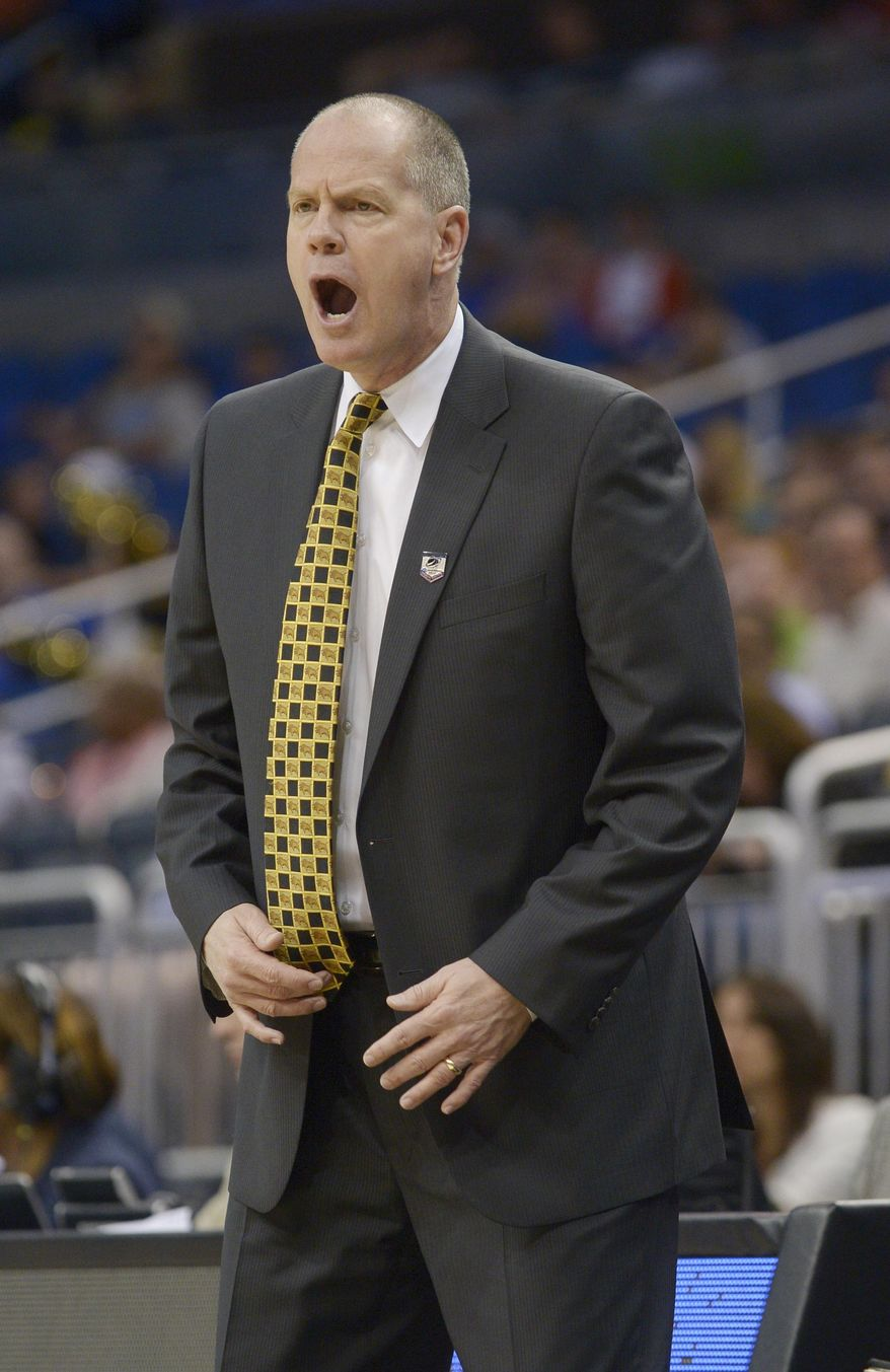 Colorado head coach Tad Boyle screams at his team in the first half during the second-round game against Pittsburgh in the NCAA college basketball tournament Thursday, March 20, 2014, in Orlando, Fla. (AP Photo/Phelan M. Ebenhack)