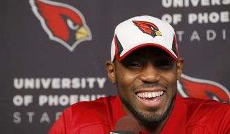 Antonio Cromartie smiles as he is introduced as an Arizona Cardinals football player during a news conference at the team's training facility, Thursday, March 20, 2014, in Tempe, Ariz.  (AP Photo/Ross D. Franklin)
