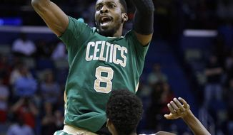 ADVANCE FOR WEEKEND EDITIONS, MARCH 22-23 - FILE - In this March 16, 2014, file photo, Boston Celtics forward Jeff Green (8) shoots over New Orleans Pelicans forward Al-Farouq Aminu (0) during the second half of an NBA basketball game in New Orleans. Green, Phoenix's Channing Frye, Timberwolves' Ronny Turiaf and Toronto's Chuck Hayes, all have recovered from serious heart conditions to continue their careers.  (AP Photo/Jonathan Bachman)