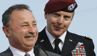 Brig. Gen. Jeffrey Sinclair, right, who admitted to inappropriate relationships with three subordinates, arrives at the courthouse with attorney Richard Scheff for sentencing Fort Bragg, N.C., Thursday, March 20, 2014. (AP Photo/Ellen Ozier)
