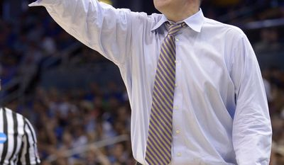 Albany head coach Will Brown gestures during the first half against Florida in a second-round game in the NCAA college basketball tournament Thursday, March 20, 2014, in Orlando, Fla. (AP Photo/Phelan M. Ebenhack)