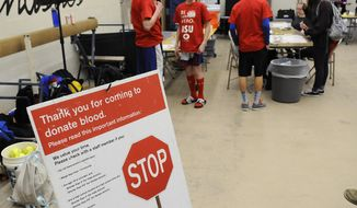 """A sign greets students at the sign-in station for a blood drive Wednesday, March 19, 2014, at Apollo High School in St. Cloud, Minn.  The annual drive is organized by the Apollo Student Union.   The number of 16-year-old blood donors in Minnesota has risen steadily since state law was changed in 2008 to allow their participation. Teens are a key demographic in blood donations, Minnesota Red Cross communications program manager Sue Thesenga said. """"Twenty percent of our blood donations come to us from high school and college students in the academic year,"""" she said. The number of participating 16-year-olds in Minnesota has grown from 3,700 donors in the 2009 fiscal year to 5,000 during the 2013 fiscal year.  Thesenga estimates that 16-year-olds can now give blood with parental consent in 45 states. When the law was passed in Minnesota in 2008, that number was closer to 25.   (AP Photo/The St. Cloud Times, Dave Schwarz)  NO SALES"""