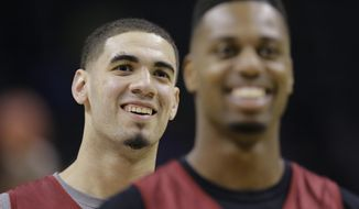 Iowa State's Georges Niang, left, and Melvin Ejim, right, line up to take free throws during the team's practice for the NCAA men's college basketball tournament, Thursday, March 20, 2014, in San Antonio. North Carolina Central will face Iowa State Friday.(AP Photo/Eric Gay)