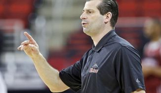 Massachusetts head coach Derek Kellogg directs his team during practice at the NCAA college basketball tournament in Raleigh, N.C., Thursday, March 20, 2014. Massachusetts plays Tennessee in a second-round game on Friday. (AP Photo/Gerry Broome)