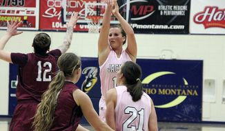 In this Feb. 15, 2014 photo provided by Montana State University Billings, Montana State Billings forward Quinn Peoples, back right, takes a shot during her team's Think Pink Night against Central Washington, in Billings, Mont. Peoples played in the NCAA Division II tournament in Pomona, Calif., with the encouragement of her 23-year-old sister Mairissa. Mairissa died of cancer on March 13, a day after Quinn left for the tournament. (AP Photo/Montana State University Billings, James Catlin)