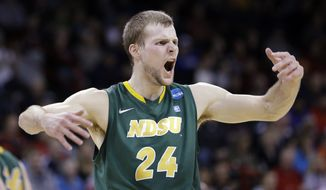 North Dakota State's Taylor Braun encourages fans after his team scored against Oklahoma in the first half of a second-round game of the NCAA men's college basketball tournament in Spokane, Wash., Thursday, March 20, 2014. (AP Photo/Elaine Thompson)