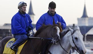 FILE - In this April 28, 2004, file photo, trainer Steve Asmussen, right, leads Kentucky Derby hopeful Quintons Gold Rush and exercise rider Scott Blasi off the track after a morning workout at Churchill Downs in Louisville, Ky. Thoroughbred racing regulators in New York and Kentucky are investigating allegations of mistreatment of horses by the Hall of Fame-nominated trainer and his top assistant. The states' racing commissions said Thursday, March 20, 2014, investigations were launched after People for the Ethical Treatment of Animals provided video evidence from an undercover investigation of Asmussen and associates.  (AP Photo/Daniel P. Derella, File)
