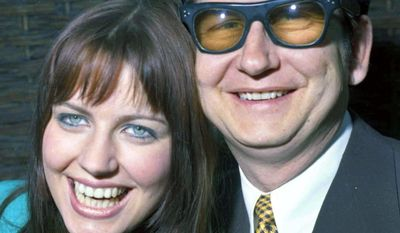 "FILE - In this April 1, 1969 file photo, American pop singer Roy Orbison poses with his then 18-year-old wife Barbara to the media in London. Orbison's three sons, Wesley, Roy Jr. and Alex Orbison have helped create a new song by their father that will appear on the 25th anniversary reissue and expansion of Orbison's final album, ""Mystery Girl"" that is being re-released on May 20, 2014.  His wife, Barbara, acted as his manager at the time he first released ""Mystery Girl,"" and even sang backup on the album.  (AP Photo/Bob Dear, File)"