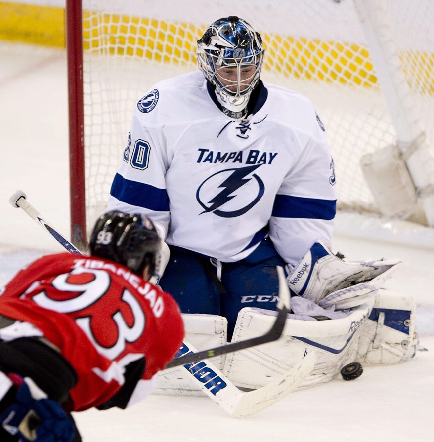 Ottawa Senators center Mika Zibanejad fires the puck on Tampa Bay Lightning goalie Ben Bishop uring the second period of an NHL hockey game Thursday, March 20, 2014, in Ottawa, Ontario. (AP Photo/The Canadian Press, Adrian Wyld)