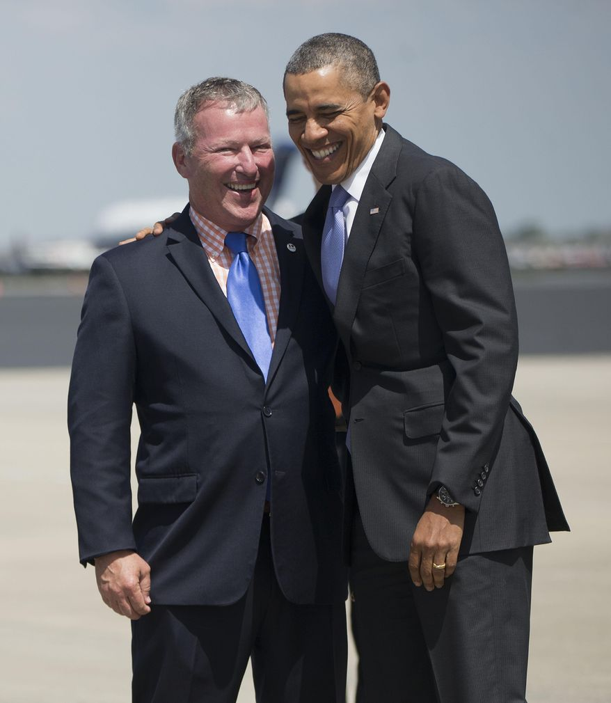 President Barack Obama is greeted by Orlando, Fla. Mayor John Dyer upon his arrival on Air Force One at Orlando International Airport in Orlando, Fla., Thursday, March 20, 2014. Obama is visiting Valencia College to highlight women's economic issues. He will also then travel to Miami for a pair of fundraisers for the democrats before returning to Washington later tonight. (AP Photo/Pablo Martinez Monsivais)