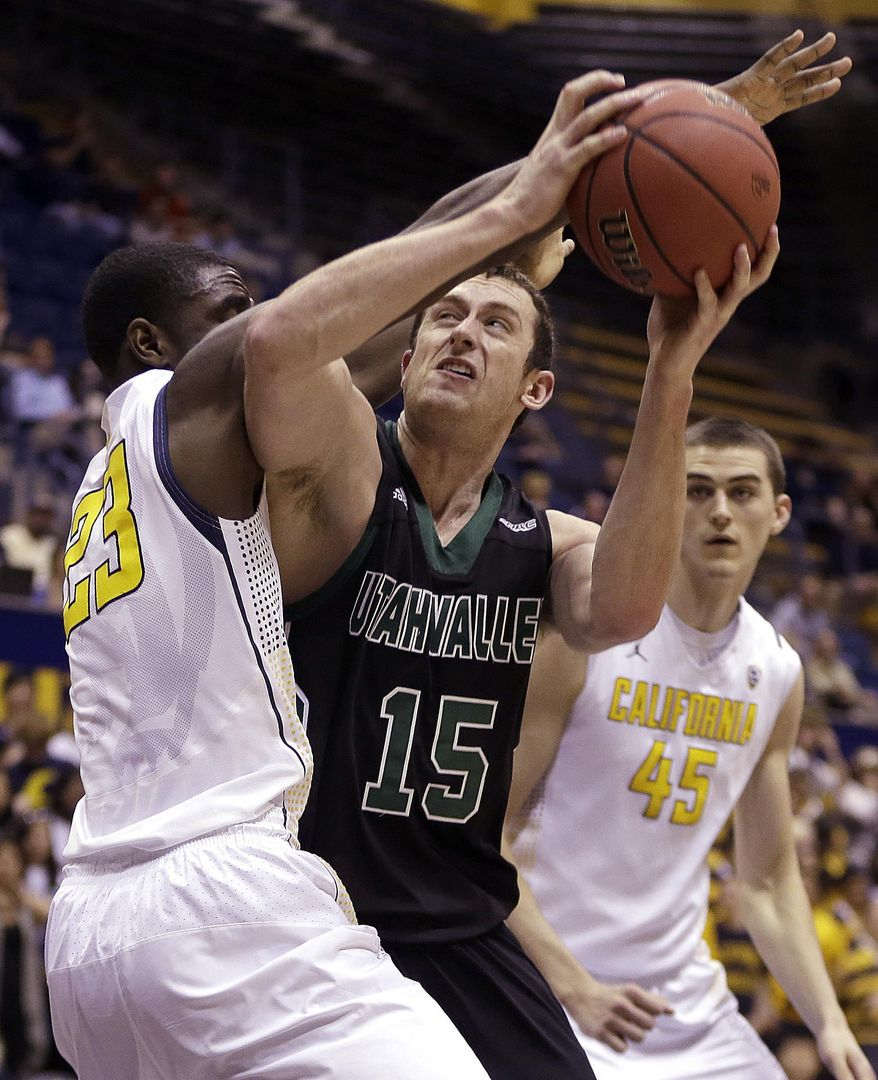 Utah Valley's Mitch Bruneel (15) looks to shoot against California's Jabari Bird, left, in the first half of an NCAA college basketball game in the NIT tournament Wednesday, March 19, 2014, in Berkeley, Calif. (AP Photo/Ben Margot)